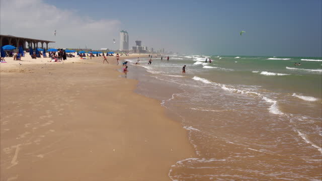 tourists on south padre island beach - gulf of mexico stock videos & royalty-free footage