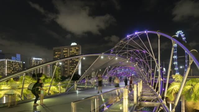 tourists on steel bridge of singapore - helix bridge stock videos & royalty-free footage