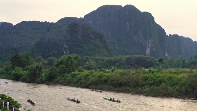 vídeos de stock e filmes b-roll de tourists on sunset traditional river boat cruise - outdoor pursuit