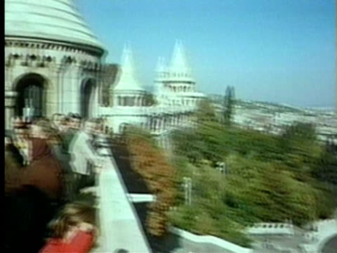 stockvideo's en b-roll-footage met 1994 ms ha pan tourists on terrace balcony of the fisherman's bastion looking towards the river danube/ budapest, hungary/ audio - neoklassiek