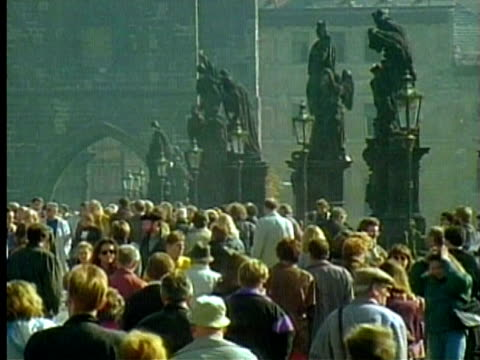 1994 montage ms tourists on the charles bridge/ ws ha the charles bridge crossing the river vltava/ prague, czech republic/ audio - 1994 stock videos and b-roll footage