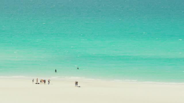 Tourists on Whitehaven Beach, Whitsundays, Australia.