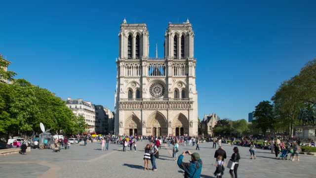 tourists outside notre dame cathedral, paris, france, europe - time lapse - cathedral stock videos & royalty-free footage
