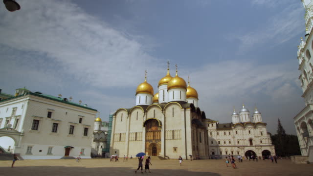 tourists outside the dormition cathedral in the kremlin - cathedral stock videos & royalty-free footage