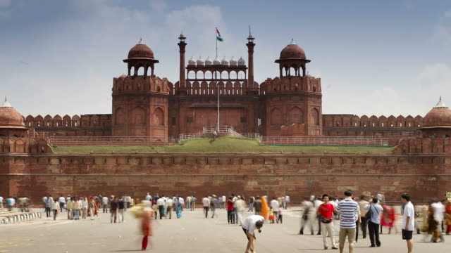tourists pass through a courtyard near the lahore gate in new delhi, india. - lahore stock videos and b-roll footage