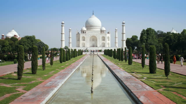 tourists pass through a courtyard near the taj mahal in agra. - agra stock videos and b-roll footage
