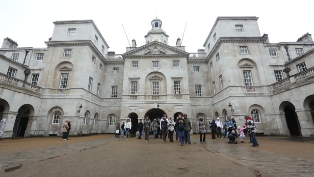 tourists pass through courtyard from horse guards parade in london wide shot horse guards parade in central london horse guards parade in london on... - courtyard stock videos & royalty-free footage