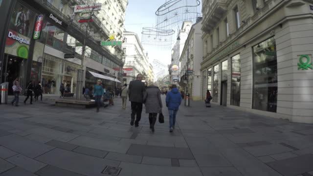 tourists people walking on karntner street or karntnerstrasse in vienna - facade stock videos & royalty-free footage