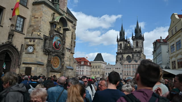 tourists photographing astronomical clock in prague, czech - astronomical clock prague stock videos and b-roll footage