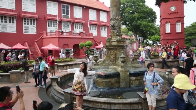 tourists pose for photographs and take selfies at dutch square in malacca city malaysia on friday july 28 2017 - malacca stock videos and b-roll footage