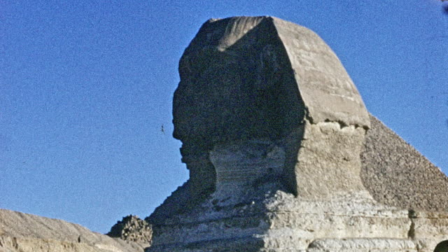 tourists pose in front of the sphinx of giza. - antiquities stock videos & royalty-free footage