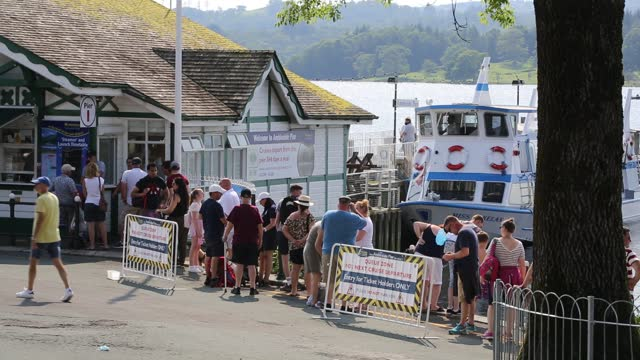 tourists queue to get on ferry boats at the head of lake windermere with tourists during the corona pandemic, ambleside, lake district, uk. - passenger ship stock videos & royalty-free footage