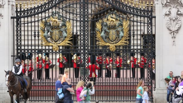 tourists queue to watch the changeing of the guard at buckingham palace, london, uk. - photography themes stock videos & royalty-free footage
