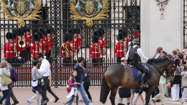 tourists queue to watch the changeing of the guard at buckingham palace, london, uk. - english culture stock videos & royalty-free footage