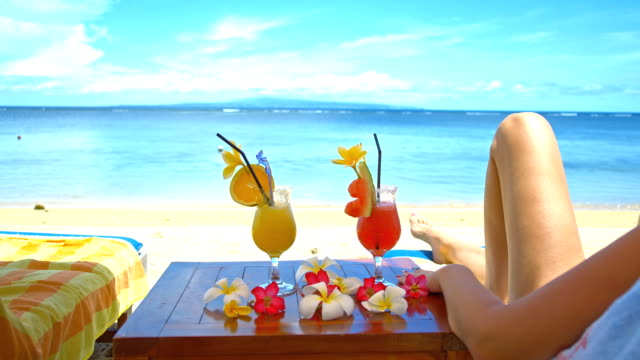 ms tourists relaxing on the tropical beach - tropical drink stock videos & royalty-free footage