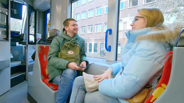 tourists ride public transport in amsterdam. - train vehicle stock videos & royalty-free footage