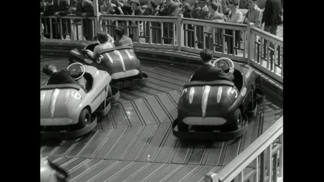 tourists riding in bumper cars on brighton seafront; 1950 - vergangenheit stock-videos und b-roll-filmmaterial