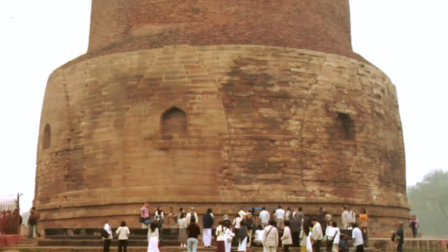 ms tu tourists roaming near dhamek stupa / sarnath, uttar pradesh, india - stupa stock videos & royalty-free footage