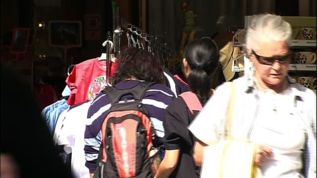 tourists shop for souvenirs in zermatt, switzerland. - souvenir stock videos & royalty-free footage