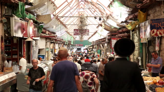 Tourists shop in the Ben Yehuda Market in West Jerusalem.