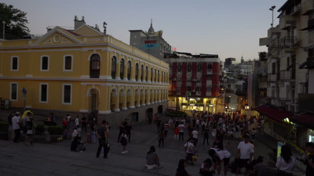 tourists shopping at patisserie shop and bakery shop near ruins of st. paul's, macao. panning shot - leal senado square stock videos & royalty-free footage
