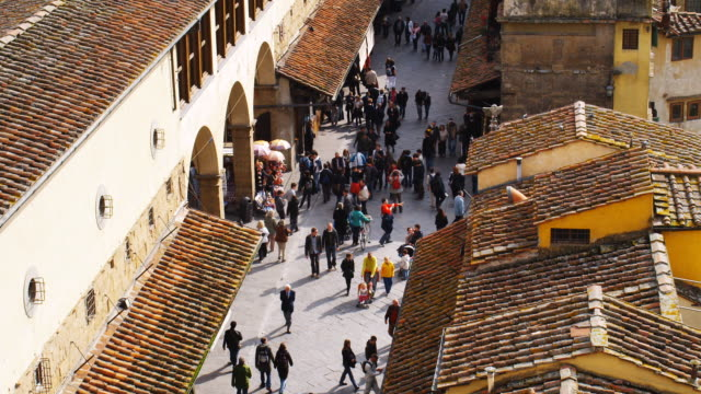 ms ha tourists shopping on ponte vecchio, florence, tuscany, italy - florence italy stock videos & royalty-free footage