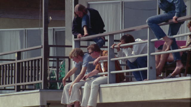 ms la tourists sitting on railing / newport beach, california, usa - 1966 stock videos & royalty-free footage