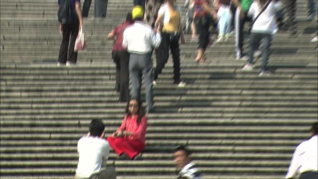 Tourists snap photos on the steps of St. Paul's Cathedral in Macao.