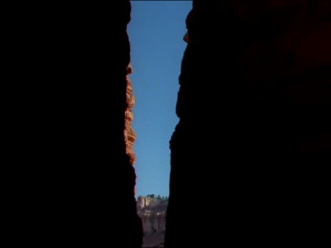 tourists stand atop a cliff in bryce canyon. - bryce canyon stock videos & royalty-free footage