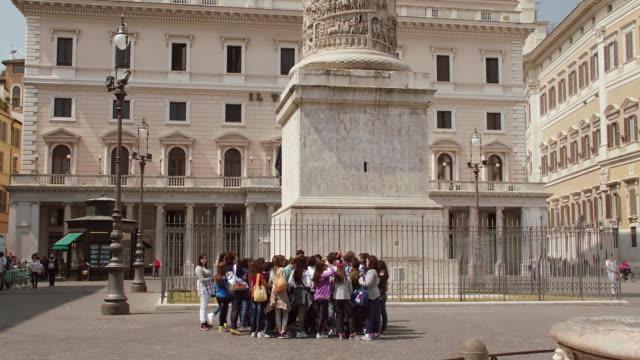 WS Tourists standing near Trajan's Column / Rome, Italy