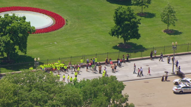 WS AERIAL POV Tourists standing outside the White House / Washington DC, United States