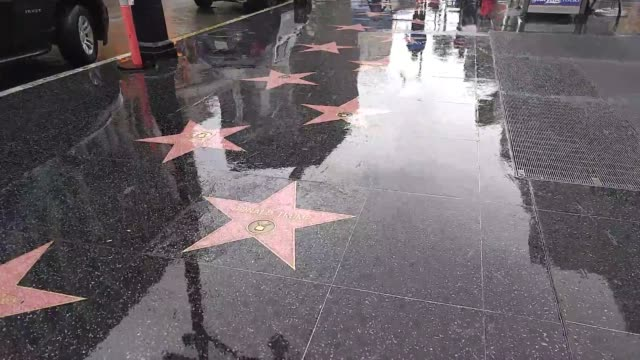 tourists stomp on and flip off donald trump star on hollywood walk of fame then a troop of asian christians walks across it while singing a petition... - plakette stock-videos und b-roll-filmmaterial