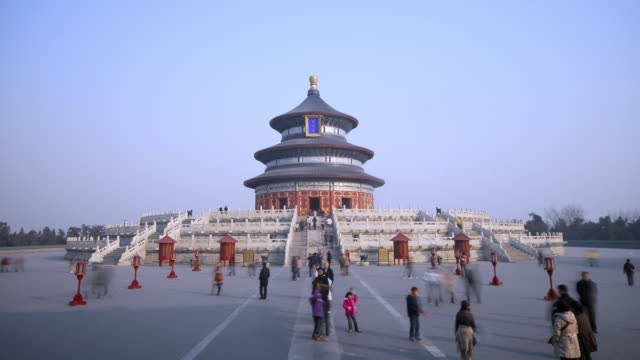 tourists stream around the temple of heaven, beijing, china - temple of heaven stock videos & royalty-free footage