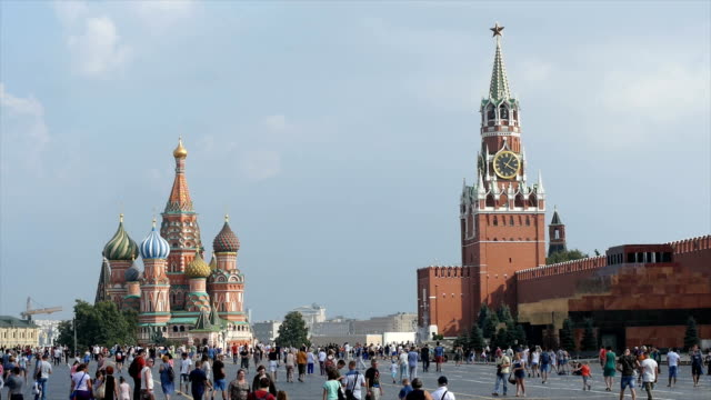 tourists stroll near st. basil's cathedral in moscow, also known as the cathedral of vasily the blessed / moscow, russian federation - st. basil's cathedral stock videos and b-roll footage