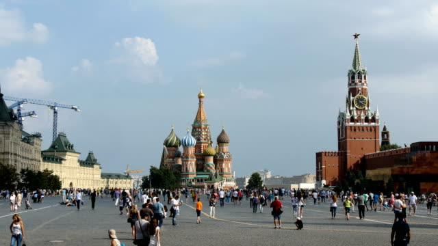 tourists stroll near st. basil's cathedral in moscow, also known as the cathedral of vasily the blessed / moscow, russian federation - courtyard stock videos & royalty-free footage