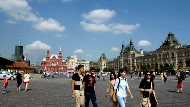 Tourists stroll near St. Basil's Cathedral in Moscow, Russia, also known as The Cathedral of Vasily the Blessed / Moscow, Russian Federation