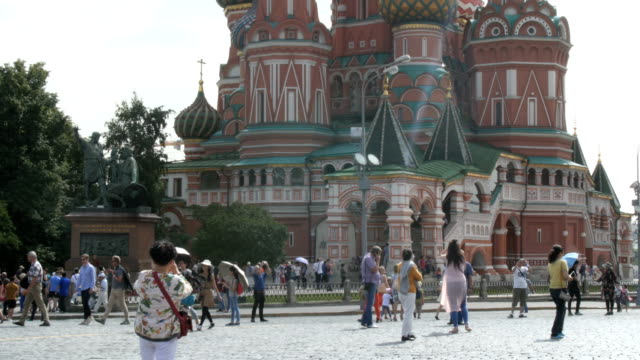 tourists stroll near st. basil's cathedral in moscow, russia / moscow, russian federation - male likeness stock videos & royalty-free footage
