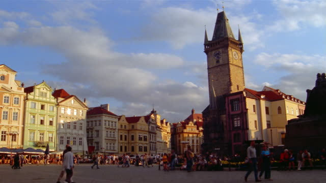 tourists stroll through the old town square in prague. - stare mesto stock videos & royalty-free footage