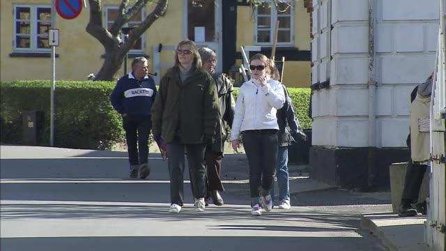 Tourists stroll through the small town of Samso on Samso Island, Denmark.