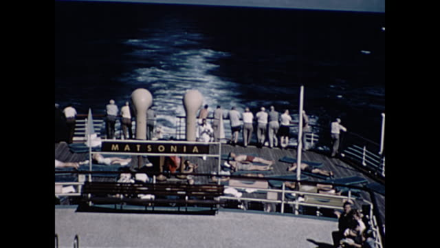 1960 tourists sunbathe on the matsonia cruise liner as it sails between los angeles and hawaii - home movie - sunbathing stock videos & royalty-free footage