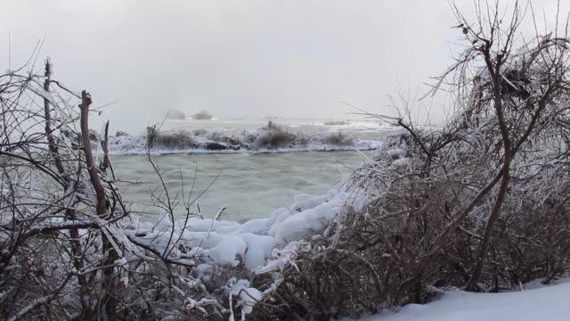 tourists take photos of the horseshoe falls in niagara falls ontario on january 06 2018 the cold snap which has gripped much of canada and the united... - niagara falls stock videos & royalty-free footage