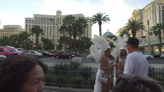 Tourists taking picture with street performers in Las Vegas.