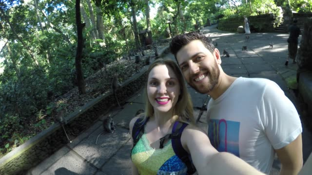 tourists taking selfie at the sacred monkey forest in indonesia - ubud district stock videos & royalty-free footage
