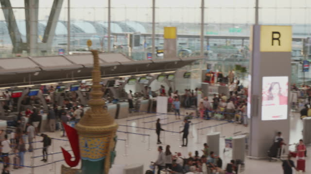 tourists, the crowd at airport check in counter hall - airport terminal stock videos & royalty-free footage