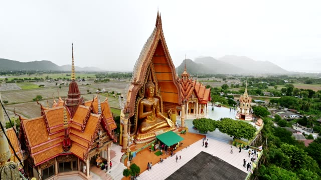 tourists to worship the big buddha statue on hill at wat tham sua - spirituality stock videos & royalty-free footage