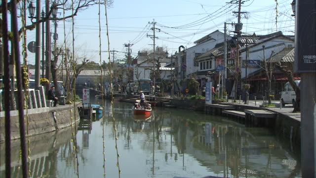 "vídeos de stock e filmes b-roll de tourists travel along moat in ""donko-bune"" sightseeing boat - vala"