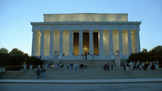 tourists trek up and down the stairs of the lincoln memorial. - statue stock videos & royalty-free footage