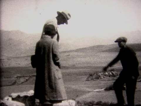 1928 tourists trying out ancient inca seat - 1928 stock videos & royalty-free footage