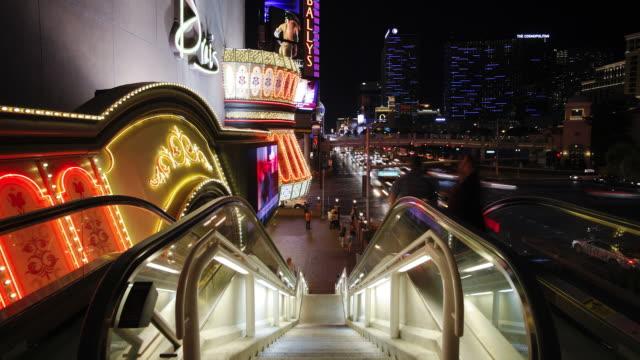 tourists use an escalator adjacent to the las vegas strip. - the strip las vegas stock videos & royalty-free footage
