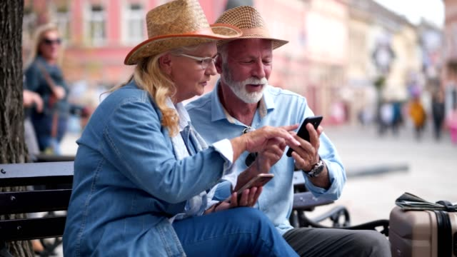 Tourists using mobile application to explore travel destination